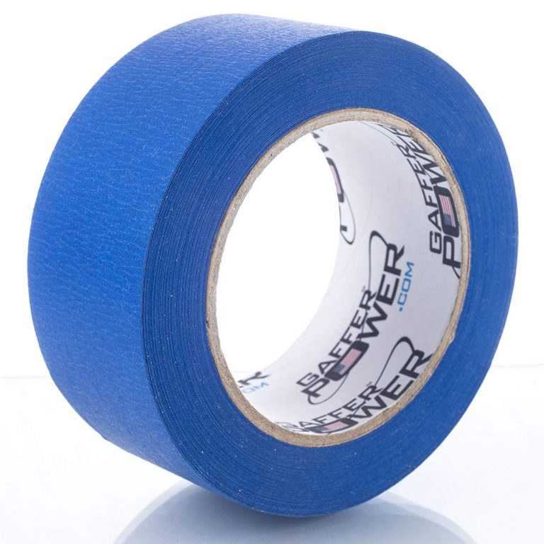 blue roll of Gaffer Power painter's tape upright on its side with a white background