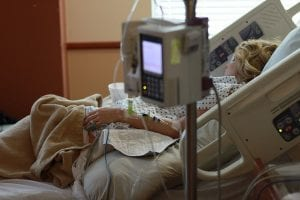 person in hospital bed needing a medical power of attorney