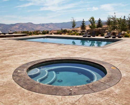 Custom In-Ground Spa with Pool and Patio
