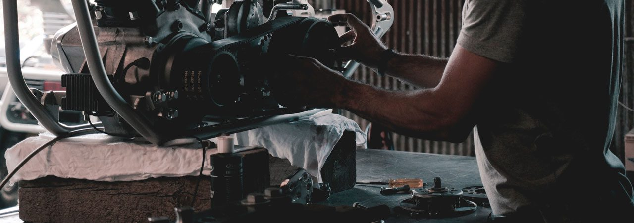 Mechanic working on car parts
