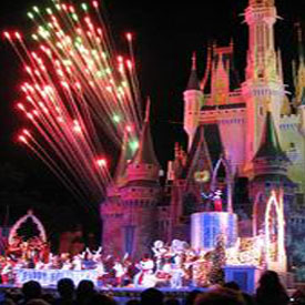 Disneyland castle at night with fireworks in the sky