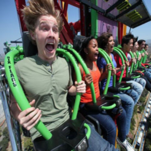 Group of people on the Lex Luthor ride at Six Flags Magic Mountain screaming