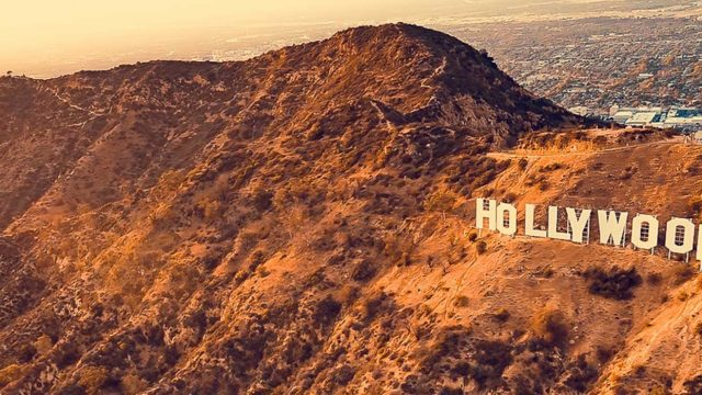 Hollywood sign on the the brown mountains of Los Angeles, CA