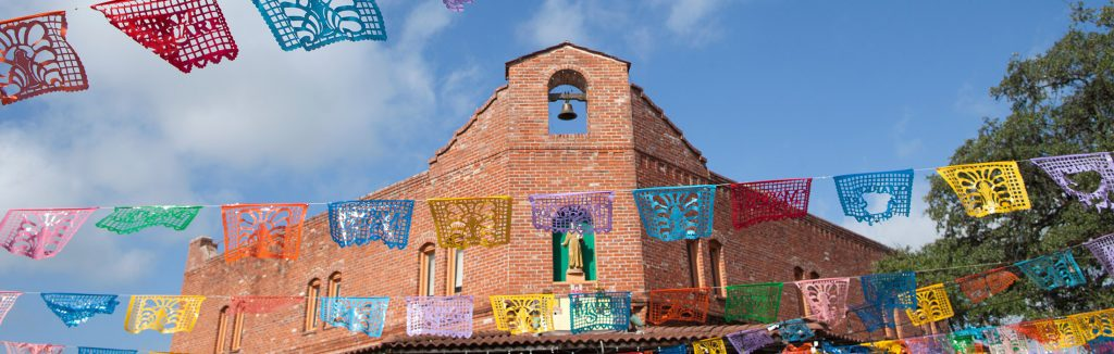 Papel Picado banners hanging throughout Historic Market Square in San Antonio, Texas