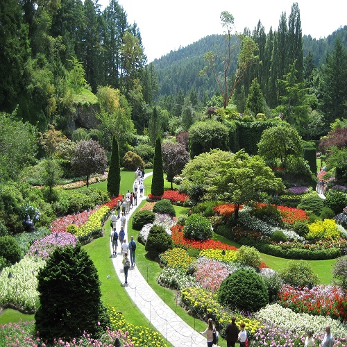 People walking along a paved trail in Butchart Gardens in Canada