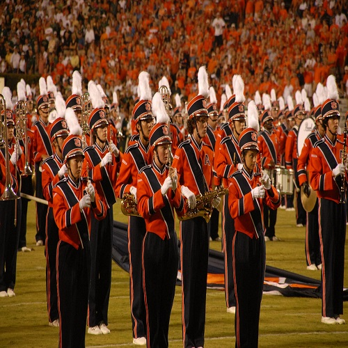 students performing in a stadium