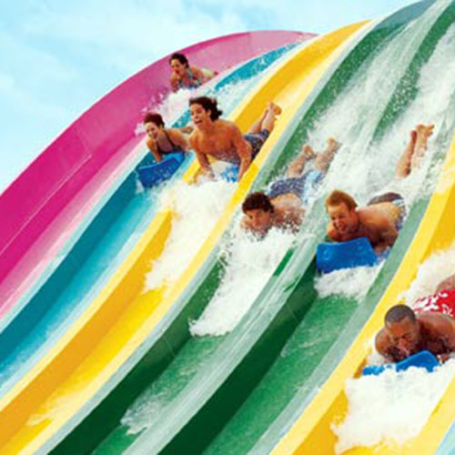 People going down steep waterslides at northern California waterpark