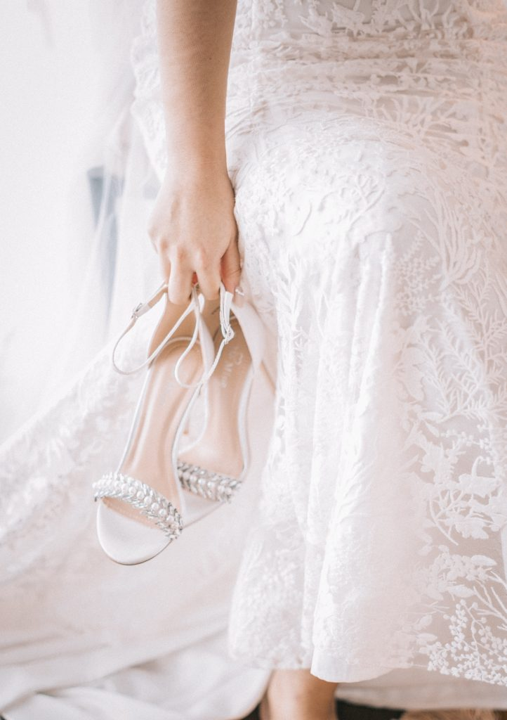 bride holding her shoes